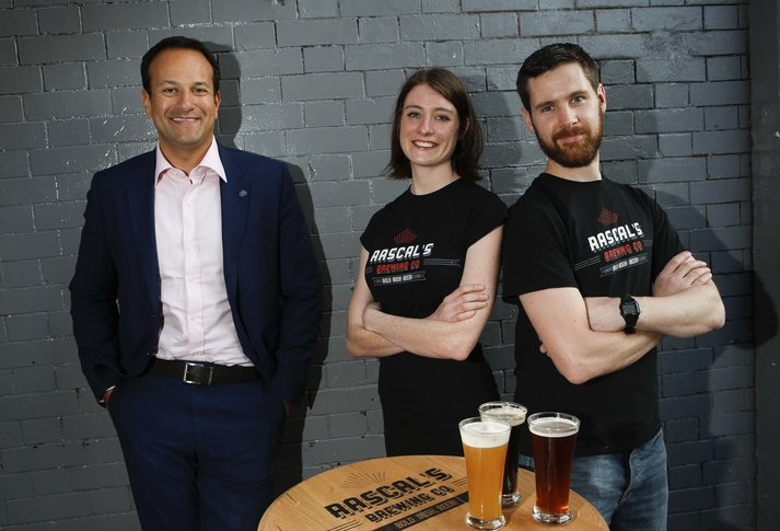 **** NO REPRODUCTION FEE **** DUBLIN : 19/06/2014 : Pictured was Minister for Transport, Tourism & Sport Leo Varadkar with founders of Rascal's Brewing Co, Emma Devlin and Cathal O'Donoghue. Founders of Rascal's Brewing Co, Emma Devlin and Cathal O'Donoghue at the brand's official launch in The Mart, Rathmines. The pair discovered their love of craft beer while living in New Zealand and on return to Ireland, they set up Rascal's Brewing Co. They now produce a range of 'Bold Irish beer', three of which were showcased at the launch – Ginger Porter, Big Hop Red and Wit Woo (a Belgian wheat beer). Based in Dublin, Emma (28) is originally from Malin Head in Donegal and Cathal (32) is from Skibbereen, (near Mizen Head). Minister of Tourism, Transport and Sport, Leo Varadkar also attended the launch'. Picture Conor MCCabe Photography. MEDIA CONTACT : Mary Crawford, The Right Angle – 087 2774739 ormary@therightangle.ie